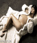 Britney Spears pregnant laying on fur rug