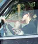 Britney Spears, with baby on lap driving SUV