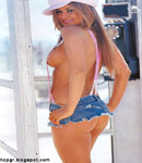 Carmen Electra phone booth with suspenders