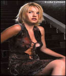 Elisha Cuthbert poking through shirt