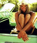 Elle Macpherson green convertible