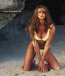 Elle Macpherson yellow fringe bikini