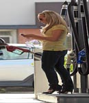 Hayden panettiere pumping gas in heels