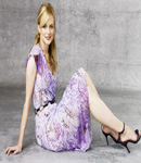 Heather Graham looking cute on the floor