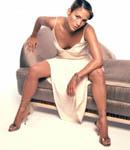 Jennifer Lopez spreading on a couch