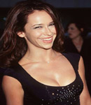 Jennifer Love Hewitt smiles and pops out