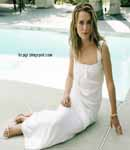 keira knightly posing in white dress and high heels