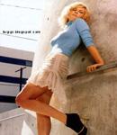 blonde Kirsten Dunst in tight dress