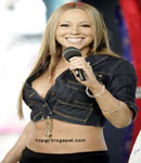 Mariah Carey smiling and showing