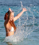 Mariah Carey splashing in white bikini