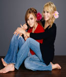 The Olsen Twins holding each other .