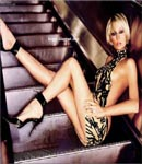 Paris Hilton posing on stairs
