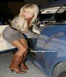 Paris Hilton fishnet stockings and high heel boots