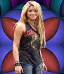 Shakira rockin out in a scorpions t-shirt