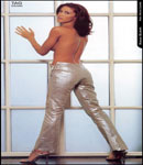 Shannon Elizabeth silver pants no top