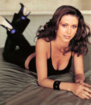 Shannon Elizabeth high heels in bed