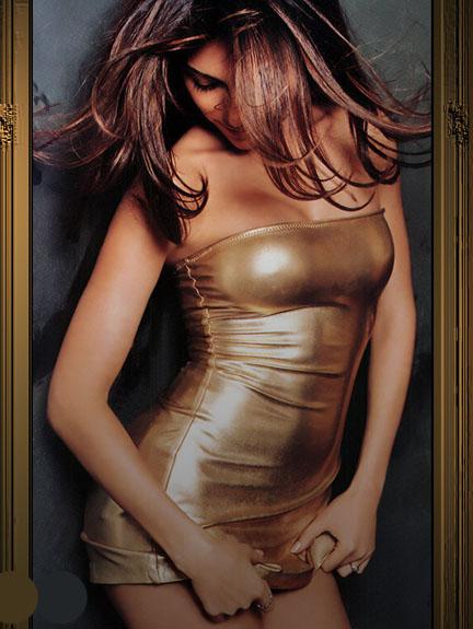 Vanessa Marcil tight gold dress