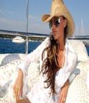 Victoria Beckham lounging boat coach