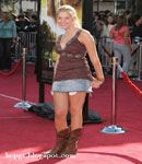 Ashley Benson denim skirt cowboy boots