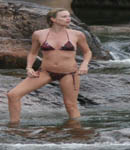 Charlize Theron on the  beach in belize