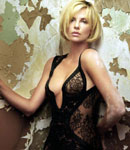 Charlize Theron models black lingerie