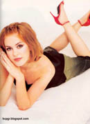 Isla Fisher red high heels