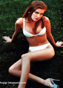 Isla Fisher bikini & spike heels