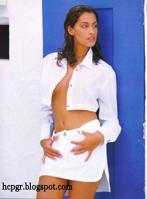 Yasmeen Ghauri white shirt and skirt