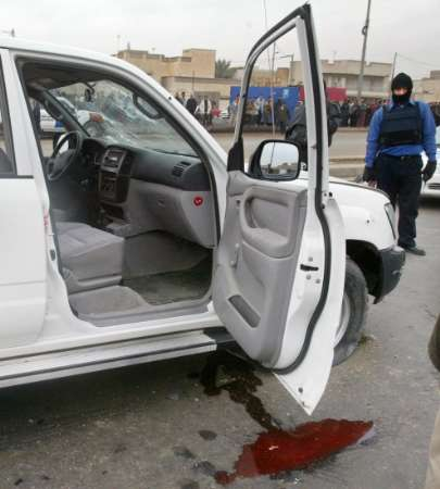 BAGHDAD, Iraq - Insurgents assassinated the highest-ranking Iraqi official in eight months Tuesday, gunning down the governor of Baghdad province and six of his bodyguards, and a suicide truck bomber killed 10 people at an Interior Ministry commando headquarters, the latest in a string of violence ahead of Jan. 30 elections. 010405