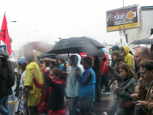 People brave the rain to march agaisnt the War in Iraq Mar.19, 2005