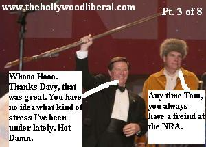 Tom Delay and a guy in a coonskin cap about to have some fun at the NRA Meeting 041605