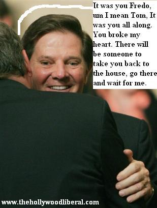 Tom Delay gets a hug from President Bush 042705