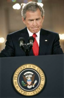 George W. Bush lies at a press conference, you can tell by the way he bites his lip