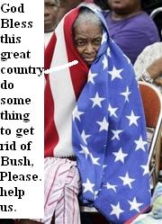 A woman draped in an American flag waits for help in New Orleans