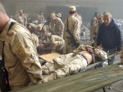 Attack on U.S. Base in Iraq Leaves 24 Dead pre Christmas mess hall bombing 12/21/04