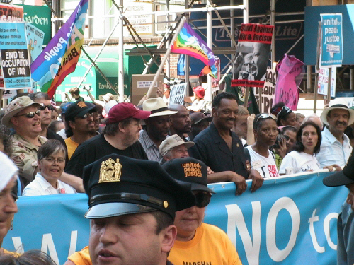 H.L. photo from the 2004 Republican National Convention in New York, Michael Moore, and Jesse Jackson lead more then 400,000 marchers agaisnt Bush