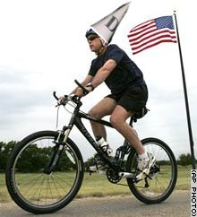 from The Tomato Observer, thats Bush on the bike, thats one for the archives