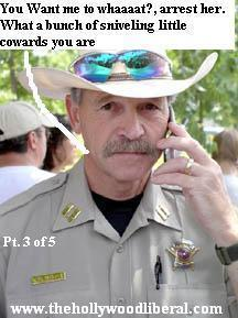 A local sheriff speaks to Cindy Sheehan in Crawford Texas as she waits to speak to the president