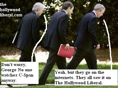Bush and Rove walking with heads down
