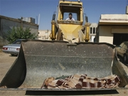 Heavy Equipment used to bury the dead in Iraq