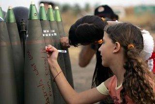 Israeli children signing missiles