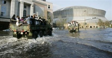 A truck full of refugees heads toward the superdome through a flood in New Orleans 082805